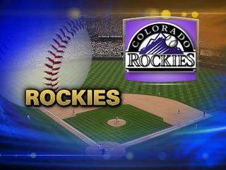 Reds pound Rockies with 5 homers in 11-8 win