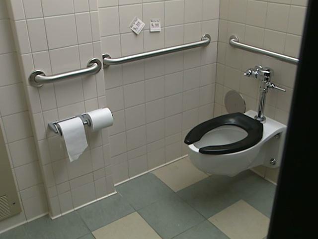 Bathroom Stall cape-wearer arrested after woman held in bathroom stall in aspen
