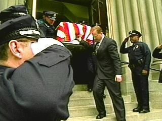 Young-funeral-officers-saluting-coffin-4487212.jpg