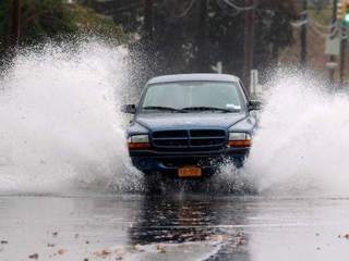 Splashing through Hurricane Sandy flood waters-10946