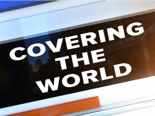 zCovering the World-10946