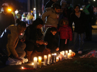 Mourners gather at a makeshift memorial-10946