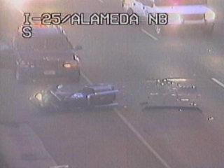 I-25 lanes clear after crash with cop