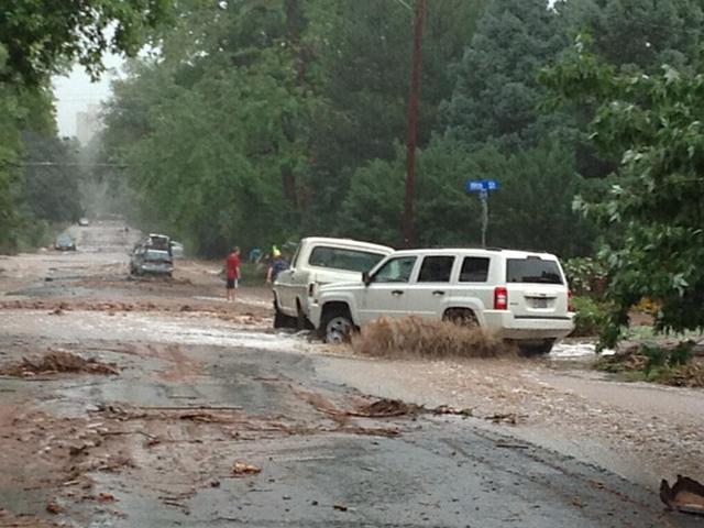 colorado flood  boulder creek hit by surge of water  debris from fourmile burn area
