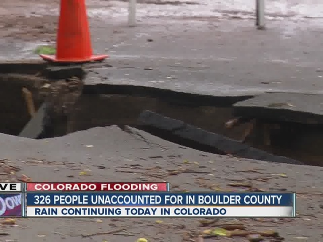 Boulder flooding opens large hole in roadway