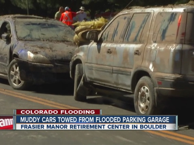 Cars in Boulder parking lot flooded