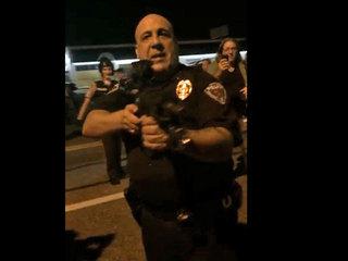 VIDEO: Cop aims gun, threatens Ferguson crowd
