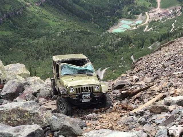 Photo Shows Damaged Jeep Hanging On Cliffside On Black