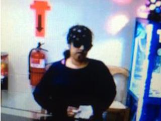 Woman draws hair on face before robbing café