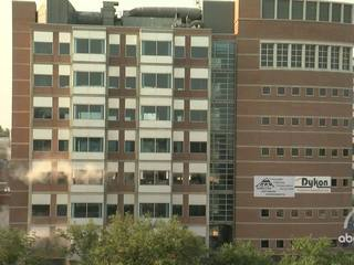 CLOSE-UP and IN REVERSE: CU building implosion