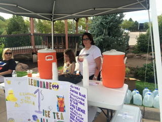 Aurora lemonade stand raises money for victims