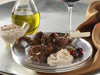 Beef skewers with garlicky white bean dip