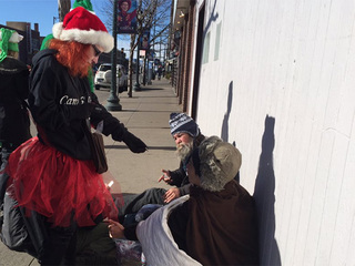 Volunteers give away free pot this Christmas Eve