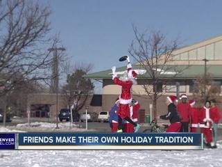 Group of Santas play ultimate frisbee in Aurora
