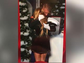 Marine surprises wife by sneaking in Santa photo