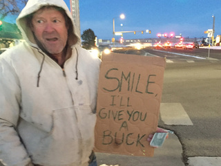 Parker man hands out a dollar for a smile