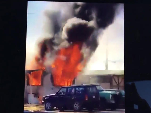 Cell phone video: Flames erupt from Adams Co. mobile home fire