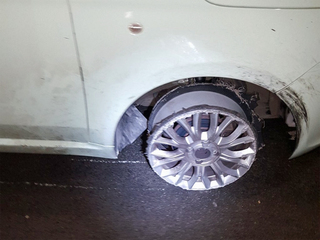 Woman arrested driving on 3 tires in UK