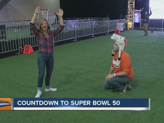 Lisa vs. Eric: Football challenge at the NFL Experience