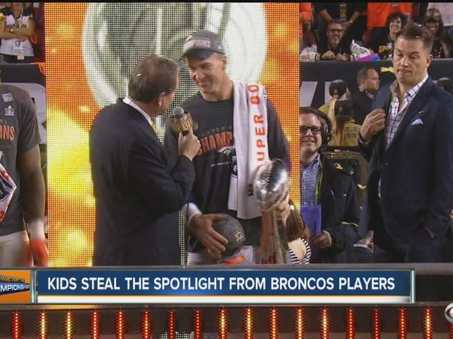 Broncos players share spotlight with their children after Super Bowl 50 victory
