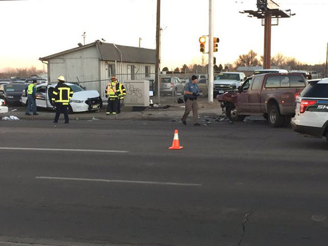 Deputy heading to homicide injured in crash