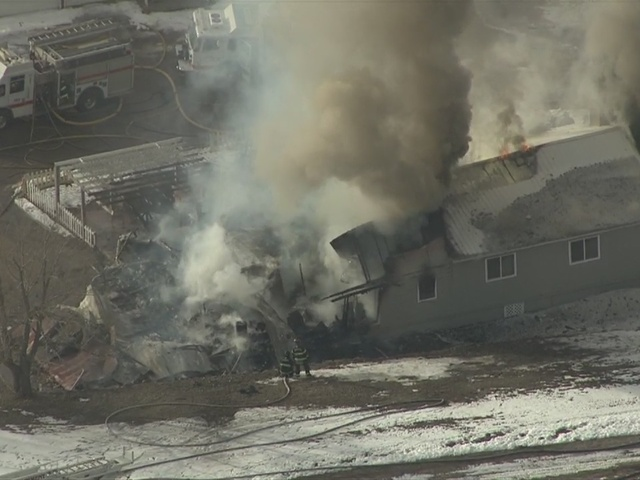 RAW: Smoke pours out of Larkspur house after fire