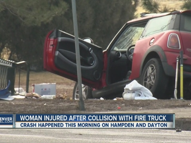 Woman injured after collision with fire truck