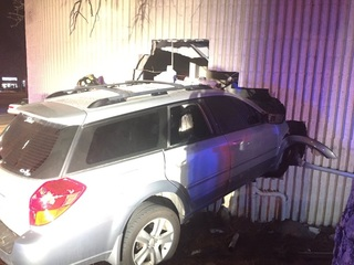 Car smashes into insurance business in Aurora