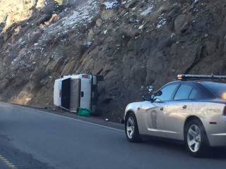 Rollover ends with pickup in odd place on U.S. 6