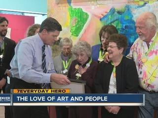 Volunteer welcomes visitors to Denver Art Museum