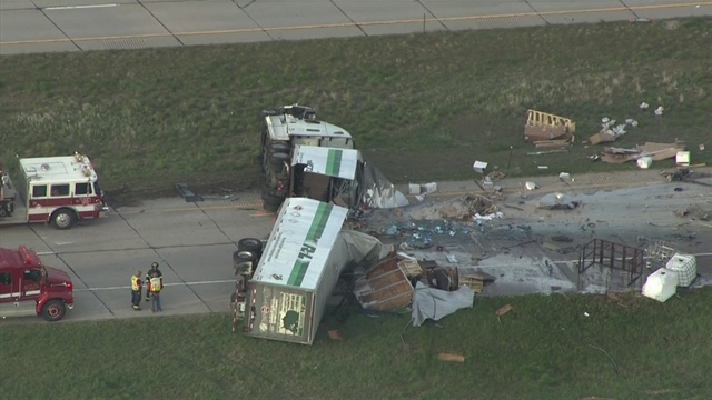 Semi cut through another semi in crash