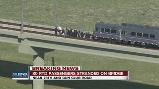 80 train riders evacuated from bridge 50 feet up