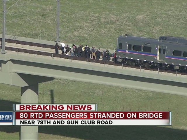 80 RTD train passengers evacuated from bridge 50 feet above the ground,…