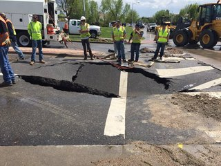Pavement buckles after water main break