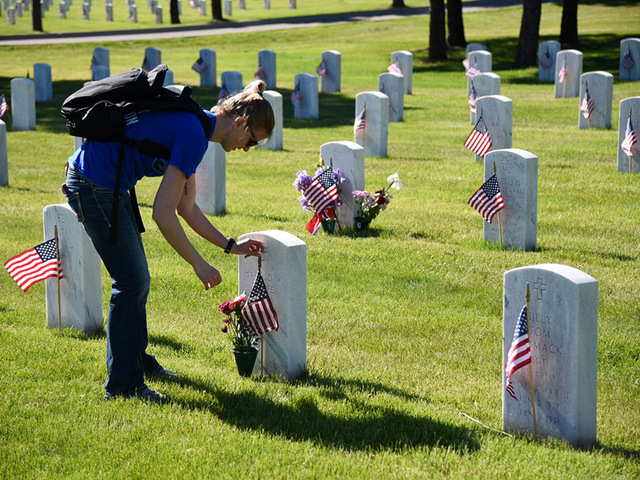 Thousands of American flags placed at tombstones in Fort Logan National Cemetery