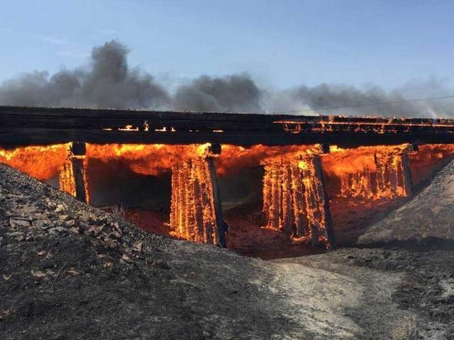 Grassfire destroys railroad trestle