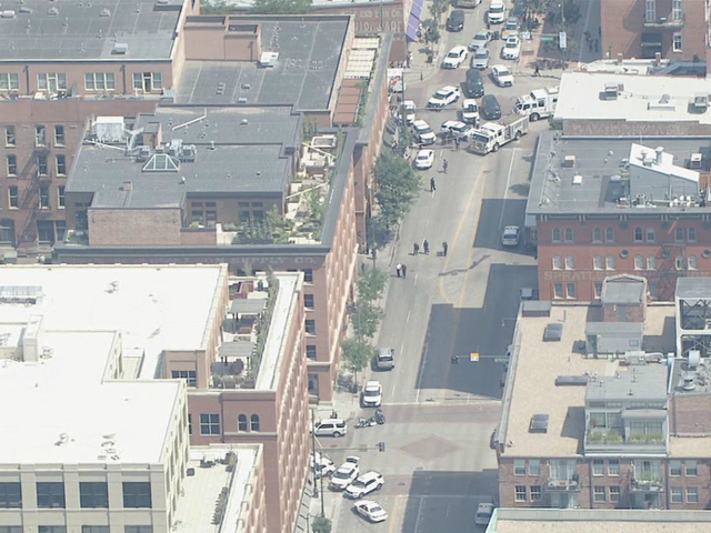 Woman shot in downtown building, gunman dead