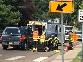 Pedestrian hit, rescued from under truck