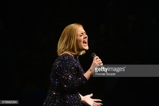 'Hello, it's me': Adele lights up Pepsi Center