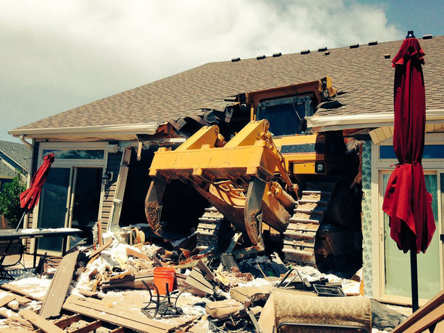 Hole patched where bulldozer ran into house