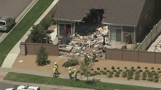 IMAGES: Bulldozer plows into house in Denver