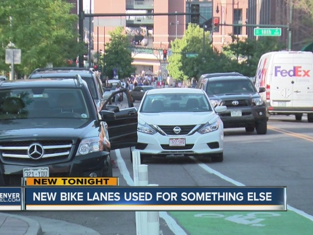 Cars using bike lanes for short stops, blocking lanes for bicyclists
