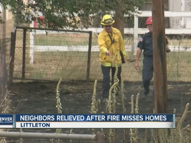 Fire burns close to homes near Chatfield State Park