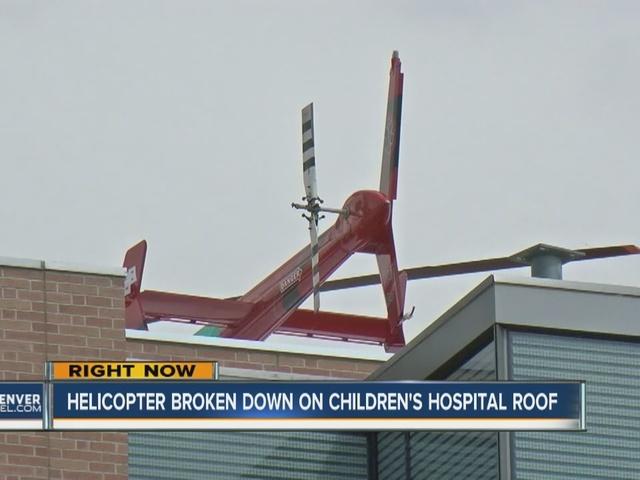 Broken helicopter stuck atop Children's Hospital in Aurora