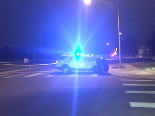 Witness: Woman shot in gun battle between gangs