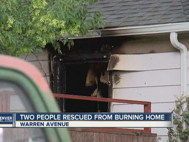 Firefighters rescue two people from burning home in Denver