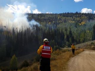 Dozen homes evacuated in Grand Co. fire