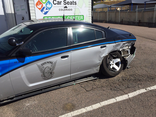Distracted driver slams into CSP car on C-470