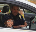 Officer subs for dad at little girl's donut day
