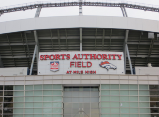 Fan dies after falling over Mile High railing